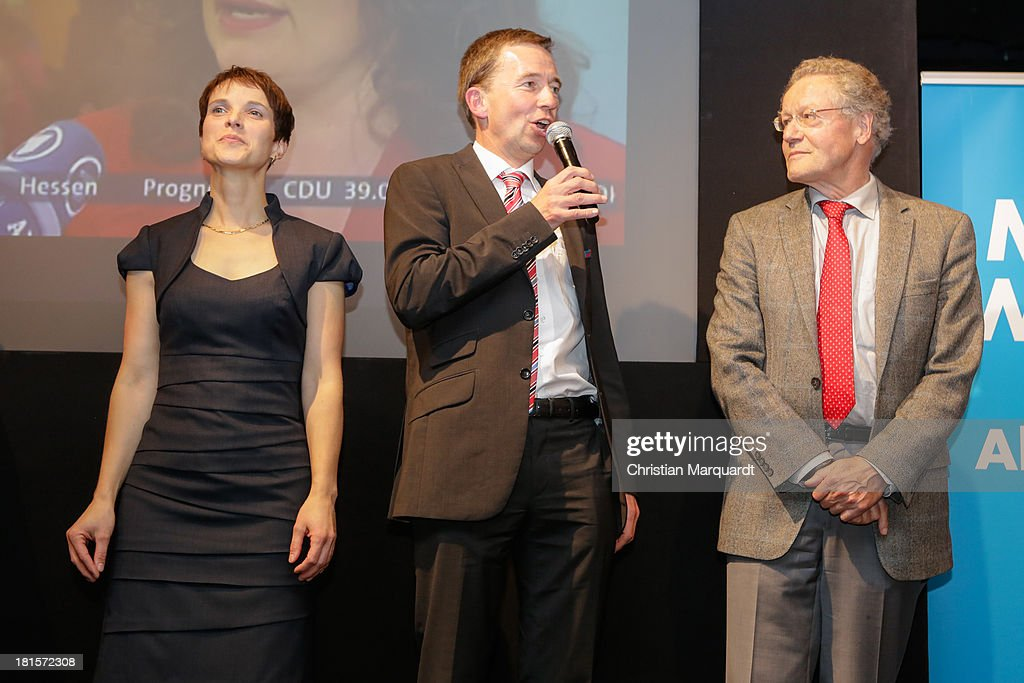 Bernd Lucke (C), head of the Euro-skeptic political party Alternative fuer Deutschland (AfD), Frauke Petry party co-spokeswoman (L) and Konrad Adam (R) party co-spokesman, react to initial exit poll results that give the party 4.9% of the vote in German federal elections at AfD party headquarters on September 22, 2013 in Berlin, Germany. Germany is holding federal elections that will determine whether current Chancellor Angela Merkel of the German Christian Democrats (CDU) will remain for a third term. Though the CDU has a strong lead over the opposition, speculations run wide as to what coalition will be viable in coming weeks to create a new government.