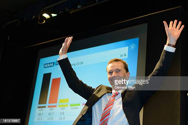Bernd Lucke, head of the Euro-skeptic political party Alternative fuer Deutschland , greets his supporters during German federal elections at...