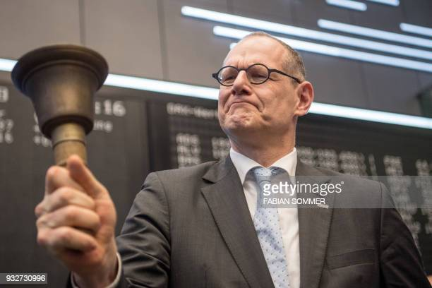 Bernd Montag chairman of German industrial giant Siemens' Healthineers unit rings the bell to launch the company's initial public offer at the stock...