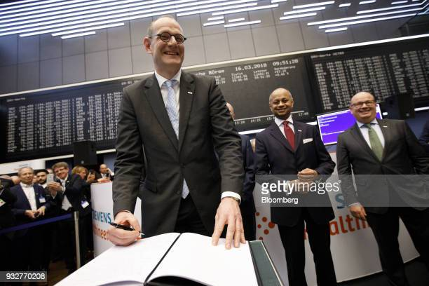 Bernd Montag chief executive officer of Siemens Healthineers AG signs a guest book as Siemens AG make an initial public offering of shares in its...