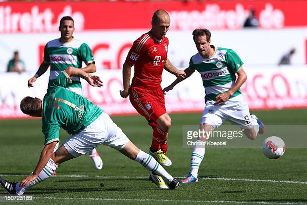 Bernd Nehrig of Fuerth and Stephan Fierstner of Fuerth challenges Arjen Robben of Bayern during the Bundesliga match between Greuther Fuerth and FC...