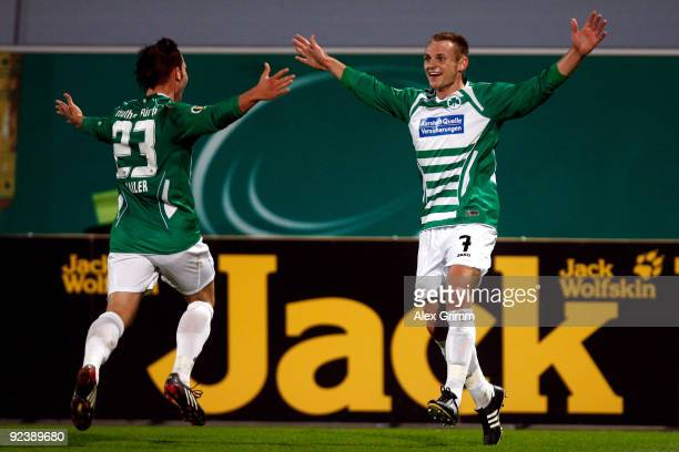 Bernd Nehrig of Greuther Fuerth celebrates his team's first goal with team mate Marco Sailer during the DFB Cup match between SpVgg Greuther Fuerth...