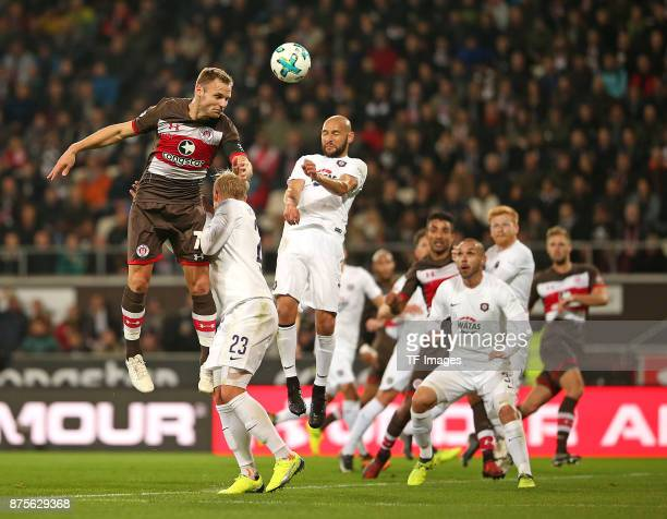 Bernd Nehrig of Pauli and Soeren Bertram of Aue and Philipp Riese of Aue battle for the ball during the Second Bundesliga match between FC St Pauli...