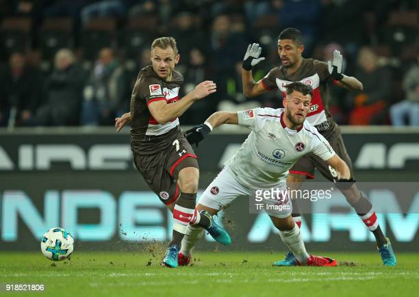Bernd Nehrig of St Pauli and Eduard Loewen of Nuernberg and Jeremy Dudziak of St Pauli battle for the ball during the Second Bundesliga match between...