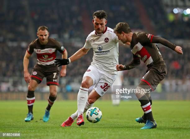 Bernd Nehrig of St Pauli and Eduard Loewen of Nuernberg and Richard Neudecker of St Pauli battle for the ball during the Second Bundesliga match...