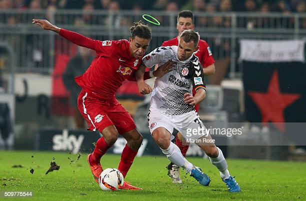 Bernd Nehrig of St Pauli challenges for the ball with Yussuf Poulsen of Leipzig during the second Bundesliga match between FC St Pauli and RB Leipzig...