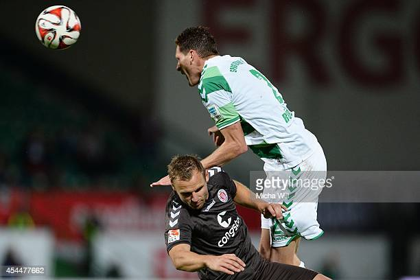 Bernd Nehrig of St.Pauli and Benedikt Roecker of Fuerth tussle for the ball during the Second Bundesliga match between Greuther Fuerth and FC St....
