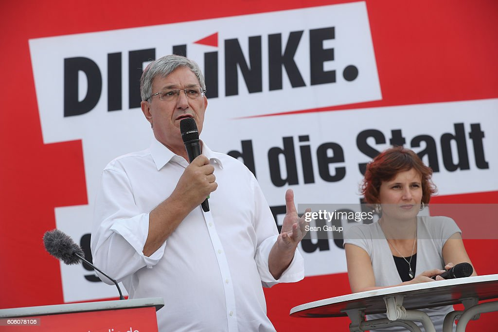 Bernd Riexinger (L) and Katja Kipping, leading members of the left-wing Die Linke political party, speak to supporters at an election campaign rally ahead of Berlin state elections on September 16, 2016 in Berlin, Germany. The city of Berlin, which is one of Germany's 16 states, or Bundeslaender, is scheduled to hold elections on September 18. The German Social Democrats (SPD) are currently ahead of the German Christian Democrats (CDU) and the Greens Party, while political newcomer the AfD (Alternative fuer Deutschland), a right-of-center populist party that has attracted far-right support, is sure to win parliament seats.
