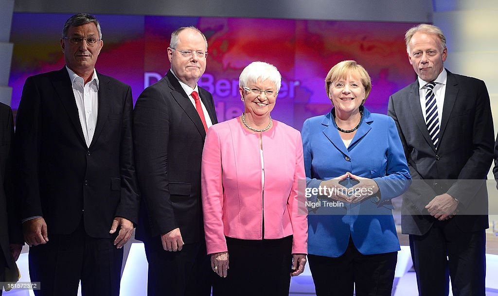 Bernd Riexinger of the German left-wing party Die Linke, Peer Steinbrueck, chancellor candidate of the German Social Democrats (SPD), Gerda Hasselfeldt, Bundestag faction leader of the Christian Social Union (CSU), Angela Merkel, German Chancellor and Chairwoman of the German Christian Democrats (CDU) and Juergen Trittin, co-lead candidate of the German Green Party (Buendnis 90/Die Gruenen) pose for the media at the end to the 'Elefantenrunde' live television broadcast at ZDF studios following federal elections on September 22, 2013 in Berlin, Germany. Today Germany is holding federal elections that will determine whether the current Chancellor Angela Merkel of the German Christian Democrats (CDU) will be voted in for a third term.