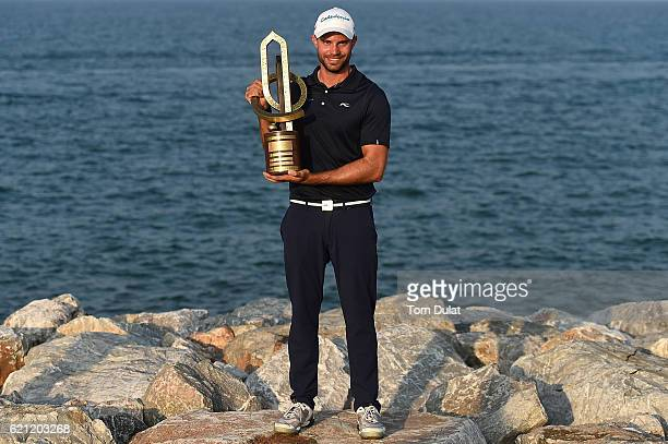 Bernd Ritthammer of Germany poses with the trophy after winning the NBO Golf Classic Grand Final at Al Mouj Golf on November 5 2016 in Muscat Oman