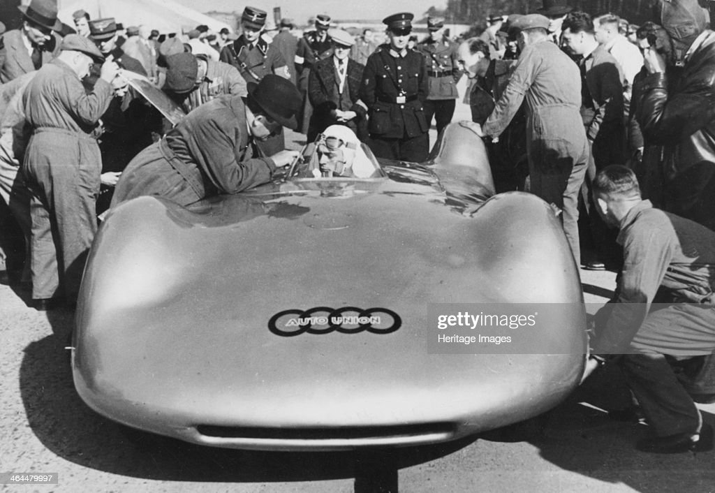 Bernd Rosemeyer and Ferdinand Porsche with Auto Union, c1937-c1938. : News Photo