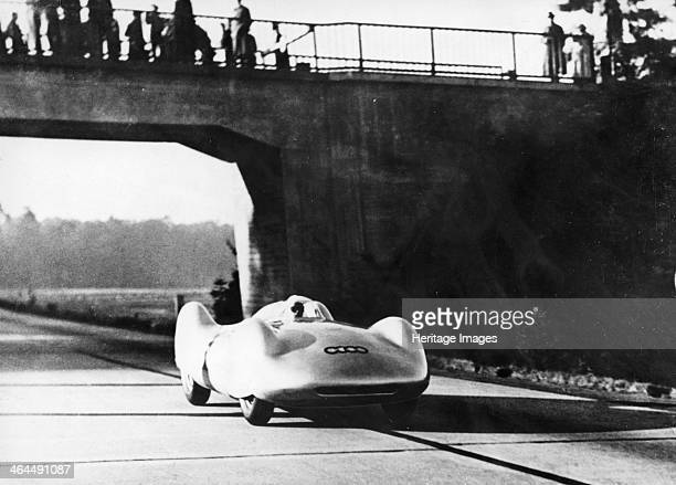 Bernd Rosemeyer driving an Auto Union c1937c1938 This streamlined vehicle designed by Ferdinand Porsche was driven by Bernd Rosemeyer to set several...