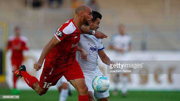 Bernd Rosinger of Lotte challenges Daniel Brueckner of Erfurt during the third league match between SF Lotte and RotWeiss Erfurt at Frimo Stadion on...
