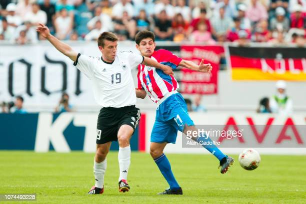 Bernd SCHNEIDER and Denis CANIZA during the FIFA World Cup match between Germany and Paraguay on June 15 2002 in Jeju Stadium South Korea