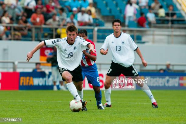 Bernd SCHNEIDER and Estanislao STRUWAY during the FIFA World Cup match between Germany and Paraguay on June 15 2002 in Jeju Stadium South Korea