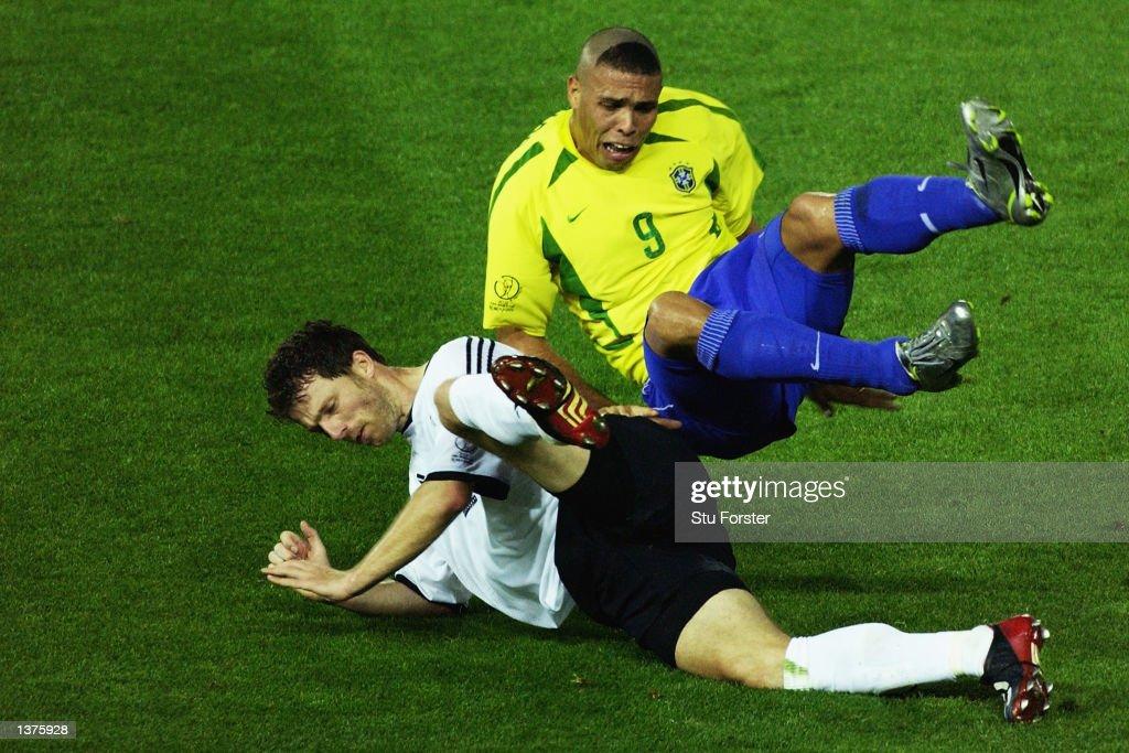 Bernd Schneider of Germany tackles Ronaldo of Brazil during the World Cup Final match played at the International Stadium Yokohama, Yokohama, Japan on June 30, 2002. Brazil won the match 2-0.