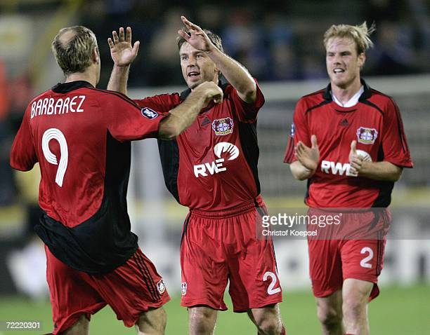 Bernd Schneider of Leverkusen celebrates his first goal with Sergej Barbarez during the UEFA Cup group B match between Club Brugge and Bayer...
