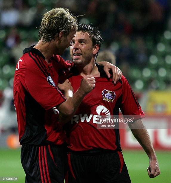 Bernd Schneider of Leverkusen celebrates scoring the fourth goal with team mate Simon Rolfes during the UEFA Cup match between Bayer Leverkusen and...