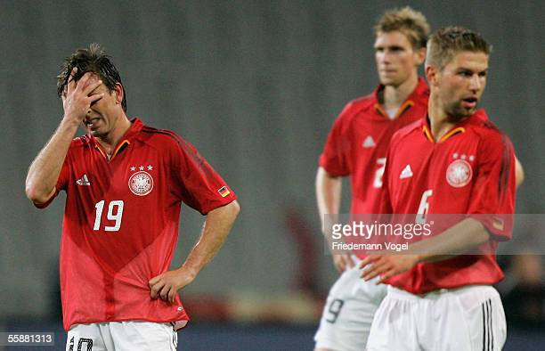 Bernd Schneider Per Mertesacker and Thomas Hitzlsberger of Germany look dejected after the friendly match between Turkey and Germany at the Ataturk...
