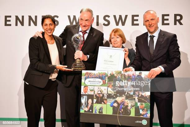 Bernd Schroeder the former head coach of the women's team of 1FFC Turbine Potsdam get the coach lifetime award 2016 from Steffi Jones head coach of...