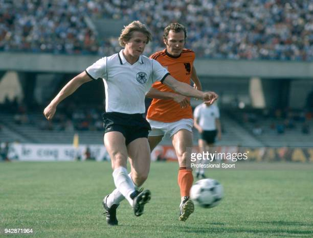 Bernd Schuster of West Germany is closed down by Willy van de Kerkhof of the Netherlands during a UEFA Euro 1980 group game at the Stadio San Paolo...