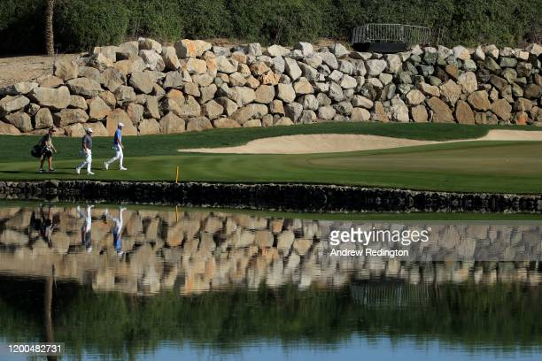 Bernd Wiesberger of Austria and Lee Westwood of England walk onto the twelfth green during the final round on Day Four of the Abu Dhabi HSBC...