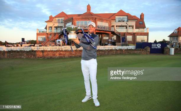 Bernd Wiesberger of Austria celebrates with the trophy following victory in the Aberdeen Standard Investments Scottish Open at The Renaissance Club...