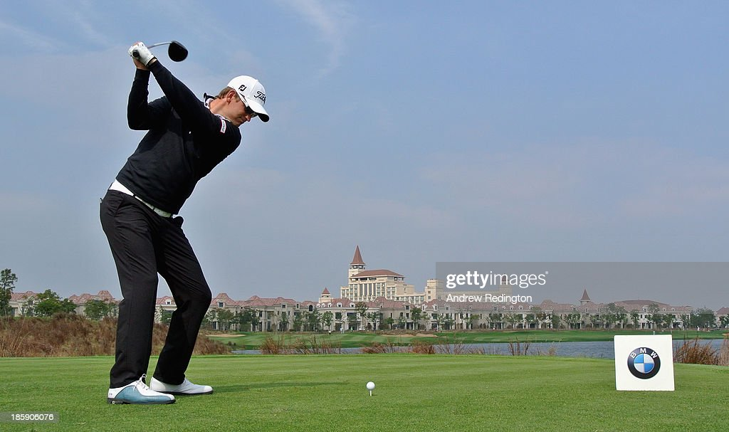 Bernd Wiesberger of Austria hits his tee-shot on the ninth hole during the third round of the BMW Masters at Lake Malaren Golf Club on October 26, 2013 in Shanghai, China.