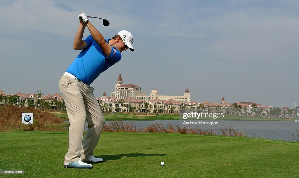 Bernd Wiesberger of Austria hits his tee-shot on the ninth hole during the final round of the BMW Masters at Lake Malaren Golf Club on October 27, 2013 in Shanghai, China.