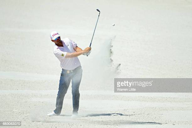 Bernd Wiesberger of Austria plays a shot from a bunker on the 11th hole during the final round of THE PLAYERS Championship at the Stadium course at...