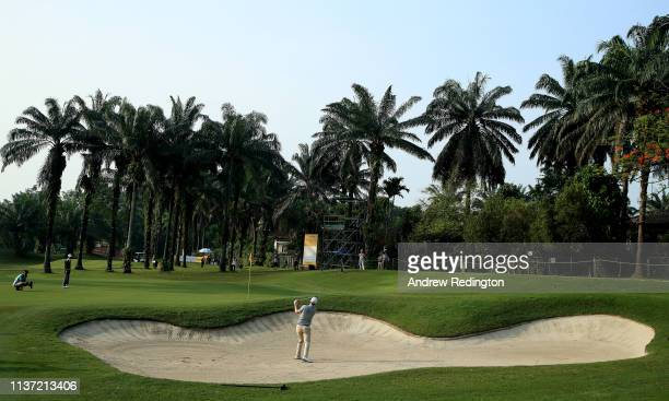 Bernd Wiesberger of Austria plays his second shot on the 12th hole on Day One of the Maybank Championship at Saujana Golf Country Club Palm Course on...