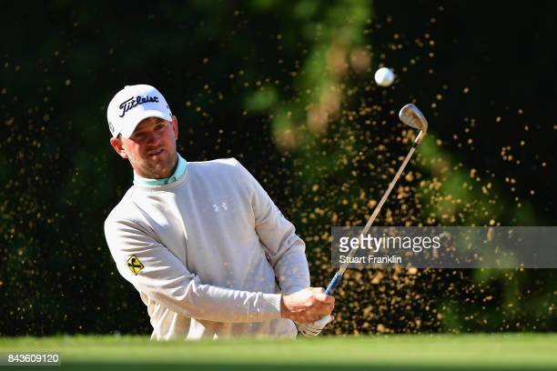 Bernd Wiesberger of Austria plays out of the bunker on the 15th during day one of the 2017 Omega European Masters at CranssurSierre Golf Club on...