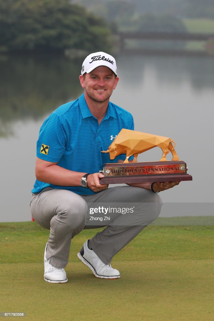 Bernd Wiesberger of Austria poses with the trophy after winning the Shenzhen International at Genzon Golf Club on April 22, 2017 in Shenzhen, China.