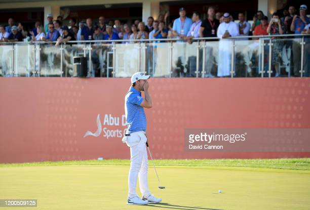 Bernd Wiesberger of Austria reacts as he just misses a birdie putt on the 18th hole during the final round of the Abu Dhabi HSBC Championship at Abu...