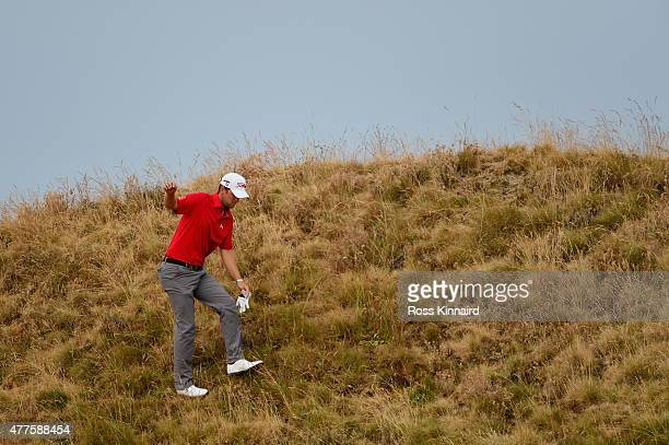 Bernd Wiesberger of Austria searches for his ball on the 11th hole during the first round of the 115th US Open Championship at Chambers Bay on June...
