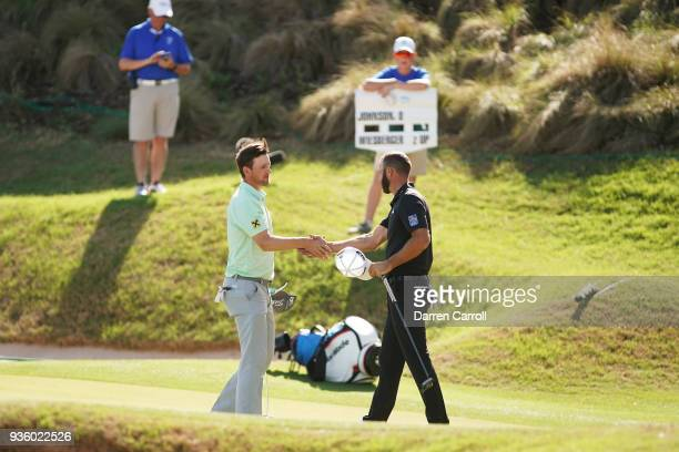Bernd Wiesberger of Austria shakes hands with Dustin Johnson of the United States after defeating him 31 on the 17th green during the first round of...