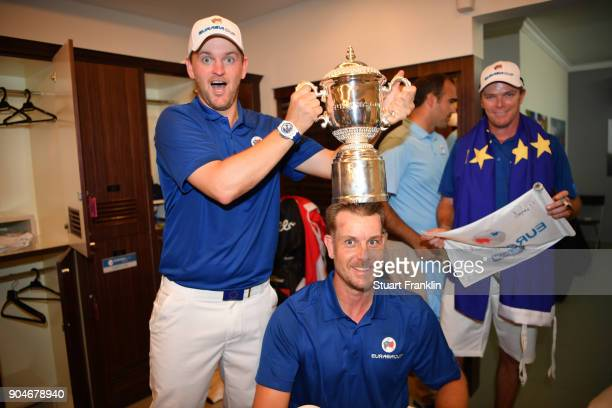 Bernd Wiesberger of Europe poses with the trophy and Henrik Stenson following his team's victory during the singles matches on day three of the 2018...