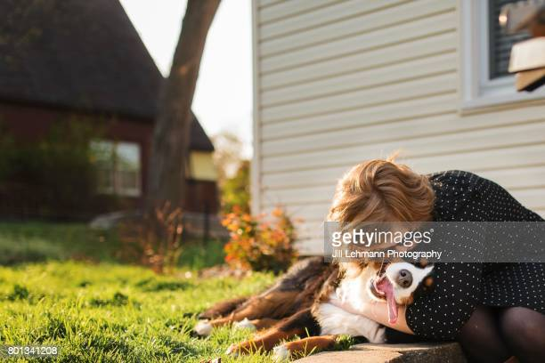 A Bernese Mountain Dog Is Hugged By Owner outside