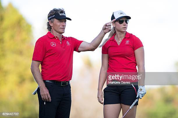 Bernhard and Christina Langer of Germany get ready to hit a shot on the 18th fairway during the first round of the PNC Father/Son Challenge at The...