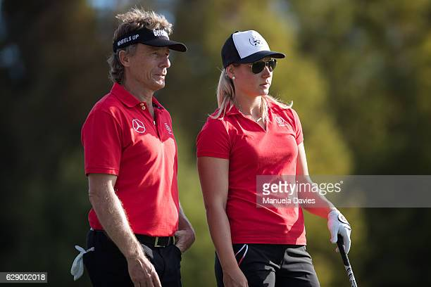 Bernhard and Christina Langer of Germany wait to hit a tee shot on the 17th tee during the first round of the PNC Father/Son Challenge at The...