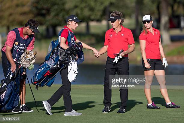 Bernhard and Christina Langer of Germany with caddies Chase De Jong and Jason Langer on the 18th fairway during the first round of the PNC Father/Son...