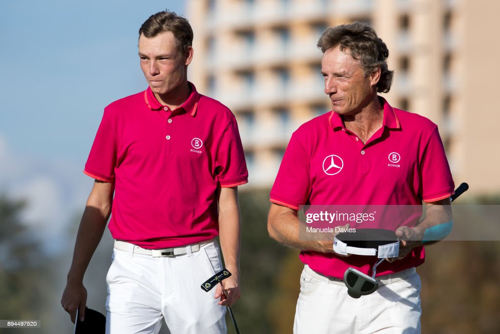 Bernhard and Jason Langer of Germany on the 18th green after their final round of the PNC Father/Son Challenge at The Ritz-Carlton Golf Club on December 17, 2017 in Orlando, Florida.