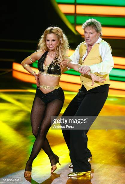Bernhard Brink and Sarah Latton perform on stage during the 1st Show of 'Let's Dance' on RTL at Coloneum on March 28 2014 in Cologne Germany