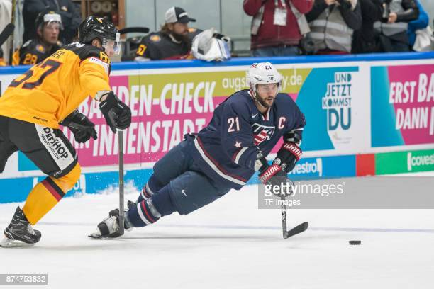 Bernhard Ebner of Germany and Brian Gionta of USA battle for the ball during the Deutschland Cup 2017 match between Germany and USA at...