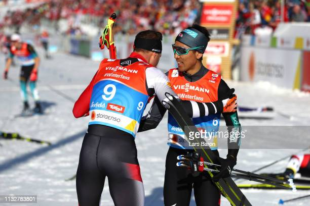 Bernhard Gruber of Austria and Akito Watabe of Japan celebrate at the finish in the Men's Nordic Combined Individual Gundersen 10km at the 2019 FIS...