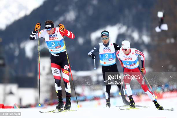 Bernhard Gruber of Austria Jan Schmid of Norway and Akito Watabe of Japan compete in Team Sprint during the CrossCountry leg for the Nordic Combined...