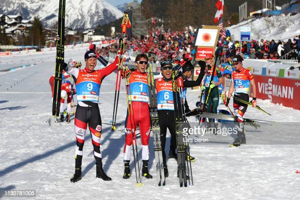 Bernhard Gruber of Austria Jarl Magnus Riiber of Norway and Akito Watabe of Japan celebrate at the finish in the Men's Nordic Combined Individual...