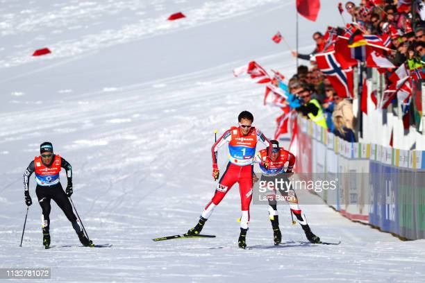 Bernhard Gruber of Austria Jarl Magnus Riiber of Norway and Akito Watabe of Japan race to the finish during at the finish in the Men's Nordic...