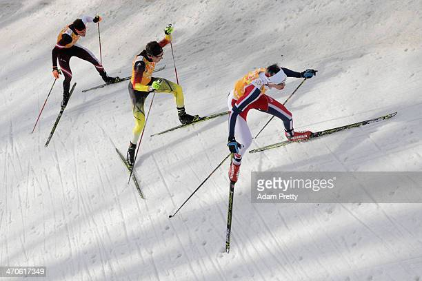 Bernhard Gruber of Austria Johannes Rydzek of Germany and Magnus Krog of Norway compete in the Nordic Combined Men's Team 4 x 5 km during day 13 of...