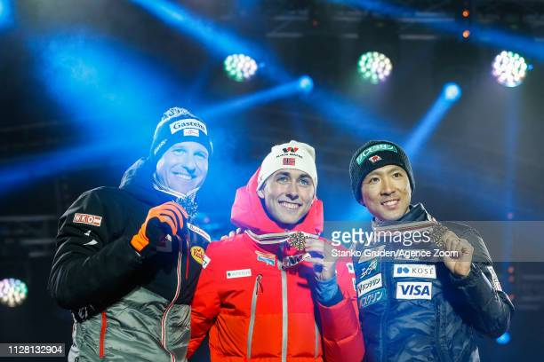 Bernhard Gruber of Austria takes 2nd place Akito Watabe of Japan takes 1st place Jarl Magnus Riiber of Norway takes 3rd place during the FIS Nordic...